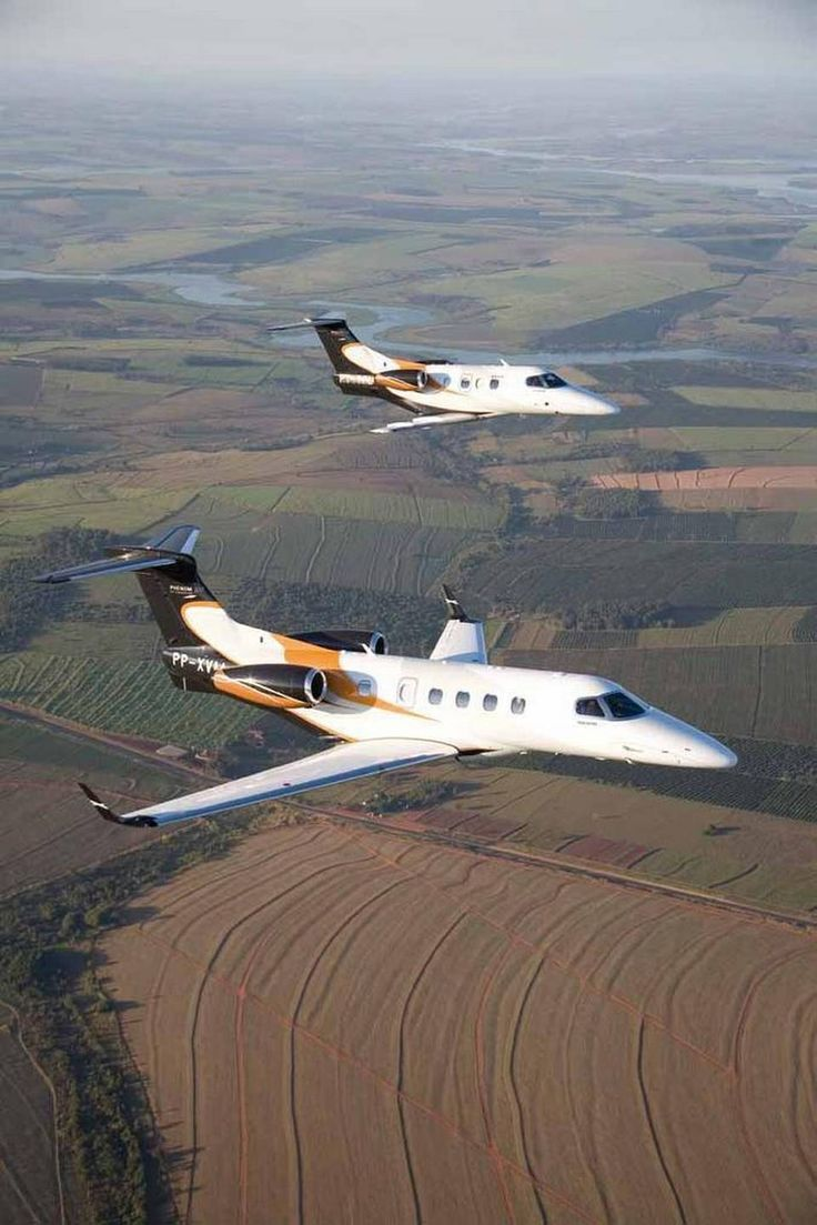 Embraer Phenom 100 & 300 Private Luxury Business Jet in flight. (960×1439)
