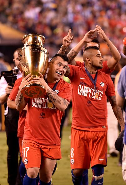 #COPA2016 #COPA100 Chile's Gary Medel holds the Copa America Centenario trophy next to Arturo Vidal during the awards ceremony in East Rutherford New Jersey United...