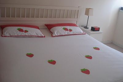 Strawberry applique on bed sheet set.. done by me.. home decor