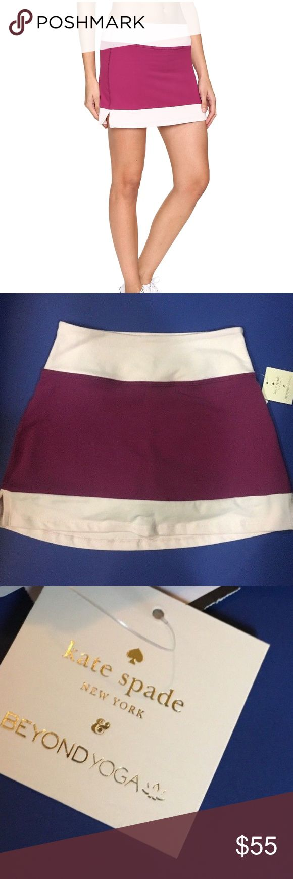 """kate spade x beyond yoga frame skirt 90% supplex, 10% lycra     fitted mini skirt with self under layer shorts     contrast self fabric waistband and hem     side slits on skirt layer     3"""" signature waistband     signature gold heat transfer logo     ultra-soft     generous stretch and full recovery     4-way stretch     moisture wicking     the real photos reflect the true color  CHECK MY STORE FOR MATCHING SEPARATES FROM THIS LINE kate spade Skirts Mini"""