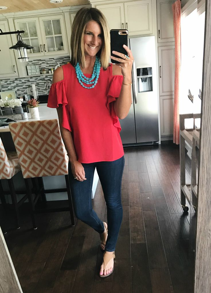 Red off the shoulder ruffle short sleeve shirt with aqua necklace for a fun  colorful look