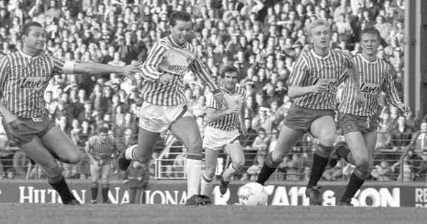 Huddersfield Town's Craig Maskell on the attack against Sheffield United, 1988