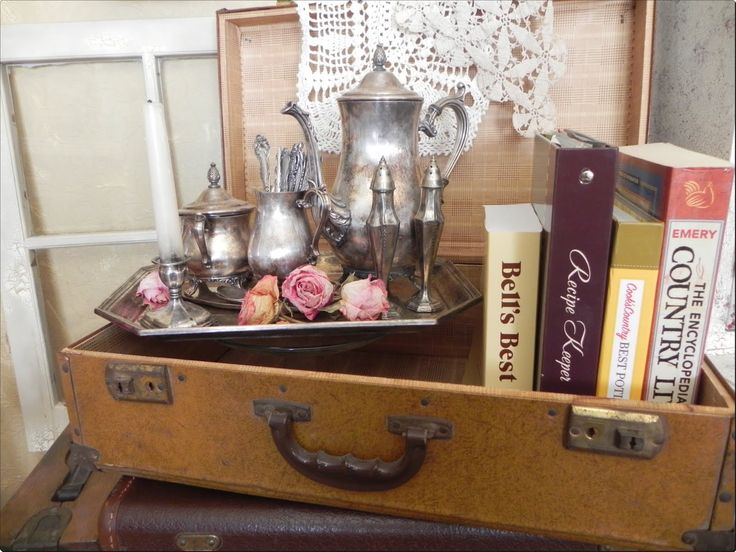 Will be doing something like this for upcoming events; vintage suitcase display