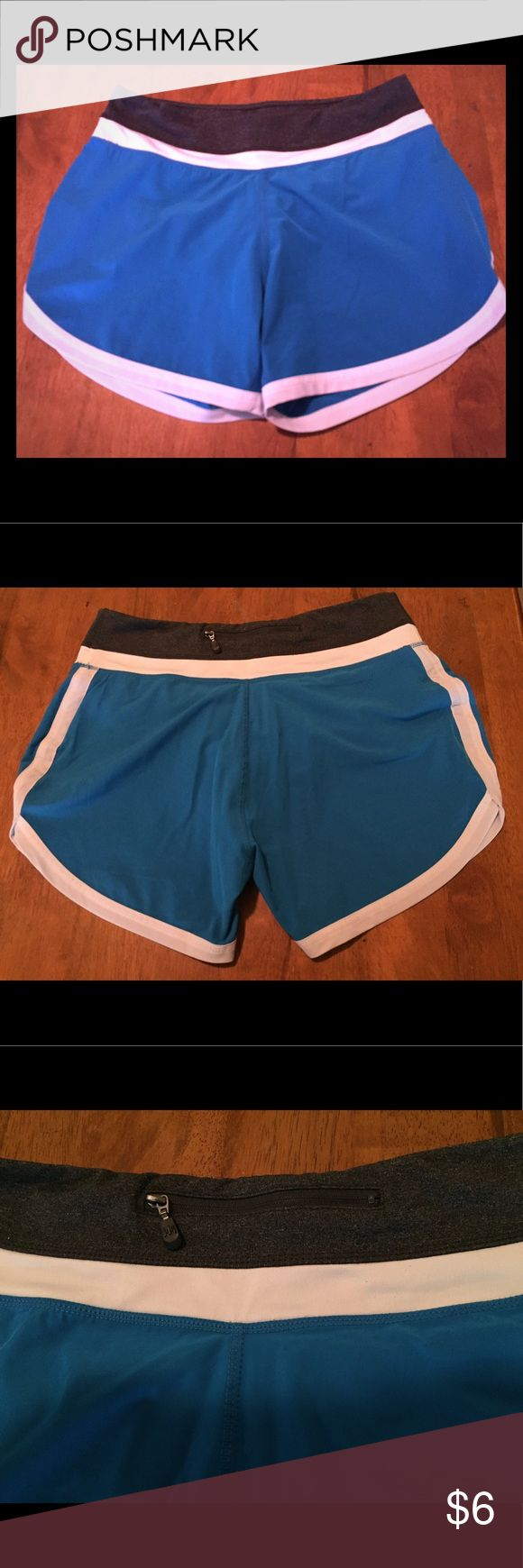 Women's Petite/Small Athletic Shorts Run in these comfy athletic shorts, or just lounge around the house in them. Pretty blue with white along the bottom and middle and a touch of gray on the top. There's a small zipper pocket in the middle on the backside of shorts along the waste band. Kyodan Shorts
