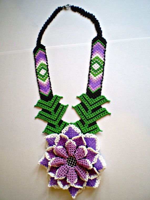 Very beautiful and delicate beaded necklace, made in the style of the American Indians Huichol.  It will complement perfectly spring and summer attire.  Necklace length 13 inches, Diameter of a flower is 4.1 inches. It perfectly fits on the chest and looks wonderful. The necklace is made in soft pink-red color with white trim. Green belt.   This necklace will be a wonderful gift for your favorite woman or girlfriend…