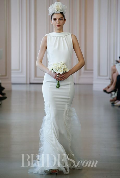 Brides.com: . Sleeveless silk crepe trumpet wedding dress with pleated tulle and chiffon skirt details, Oscar de la Renta