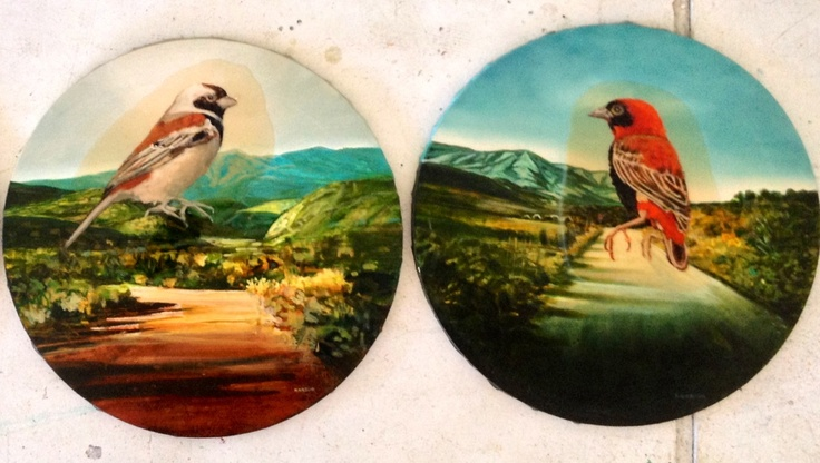 A sparrow and red bishop, cast in amber