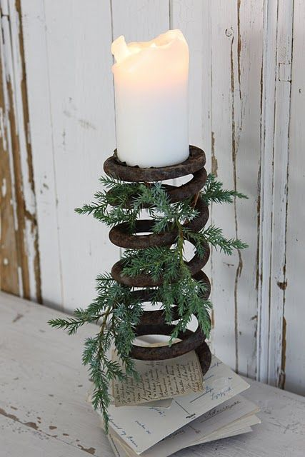 Rusty spring used as candle holder. And place to put all the