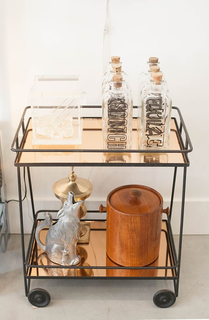 can you imagine a more perfect addition to a party than this luxe copper bar cart?