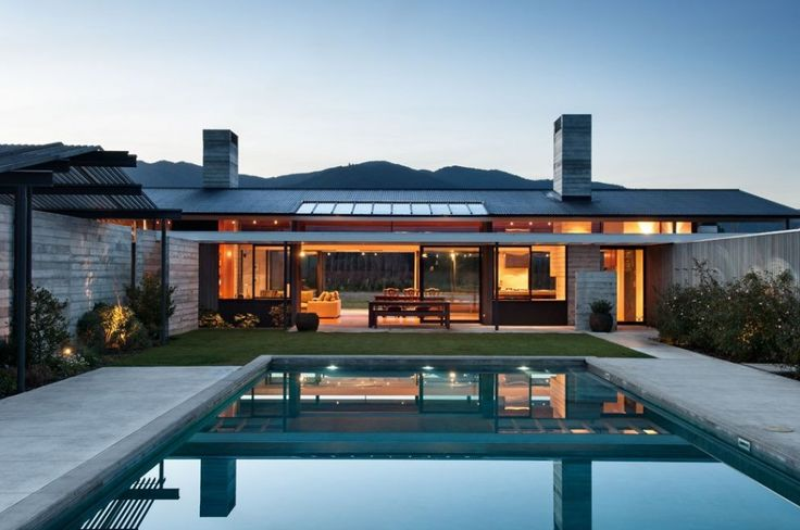 Modern ranch style home in concrete and wood.