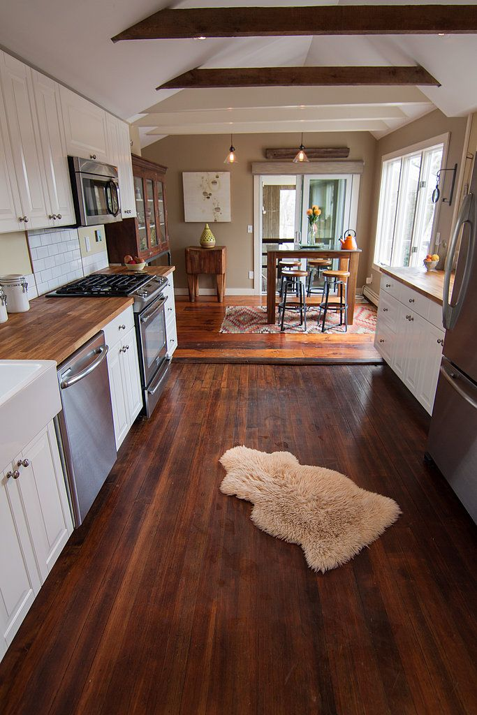 A cape cod fixer upper becomes a fantasy beach house for Is it ok to put hardwood floors in a kitchen