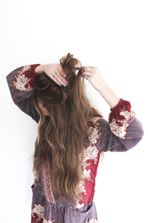 When doing a messy bun I won't put up all of my hair at once; I take my hair piece by piece and fold it into my other hand, which creates texture. By also pulling up the extensions on the other side, the bun will look thicker.