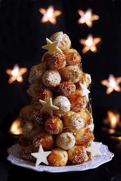 "Croquembouche de Noël THIS is a GREAT dessert made by Italian Bakeries..These directions are in Italian..you can ""translate "" the page..if you love this dessert- it is worth the effort..."