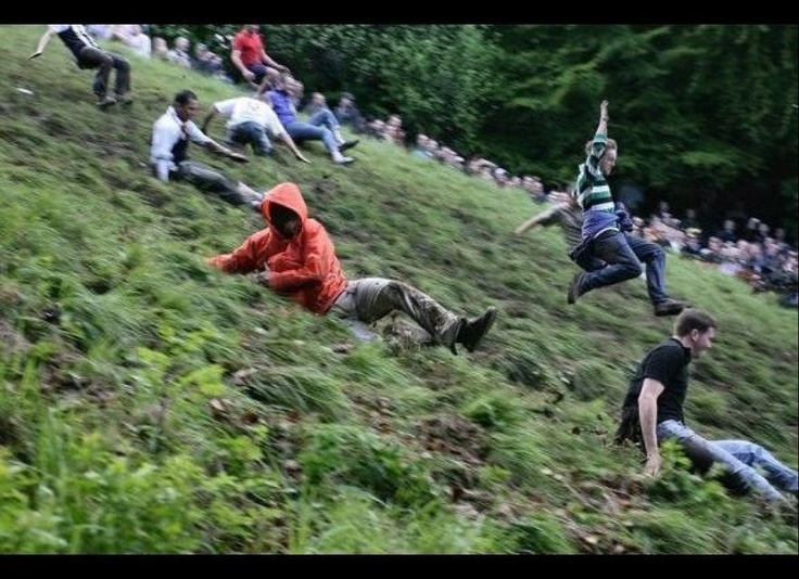 Allegedly a 200-year-old tradition, the annual Cheese-Rolling festival in Gloucestershire, England, involved tossing a round of Double Gloucester cheese down a very steep hill and flinging oneself after it. The first person to tumble across the finish line wins the big cheese. For masochists and turophiles only. June 4th, 2012