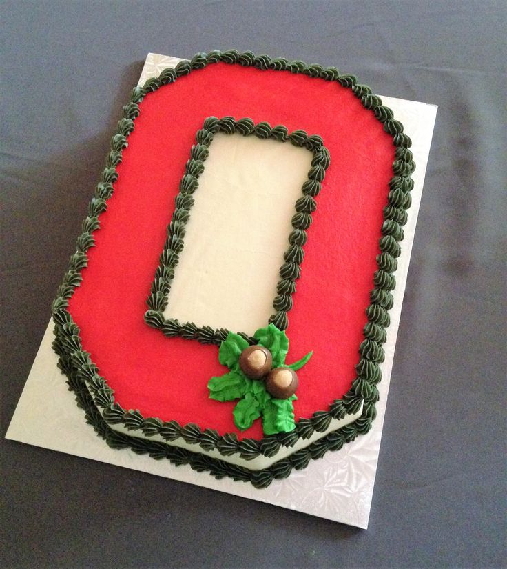 Ohio State cake, decorated with buttercream icing and 2 befitting homemade buckeyes.