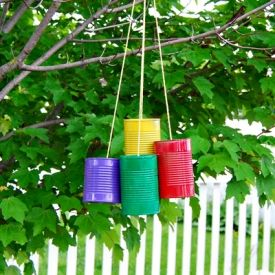 See how to make a tin can wind chime - the perfect summer craft for kids!