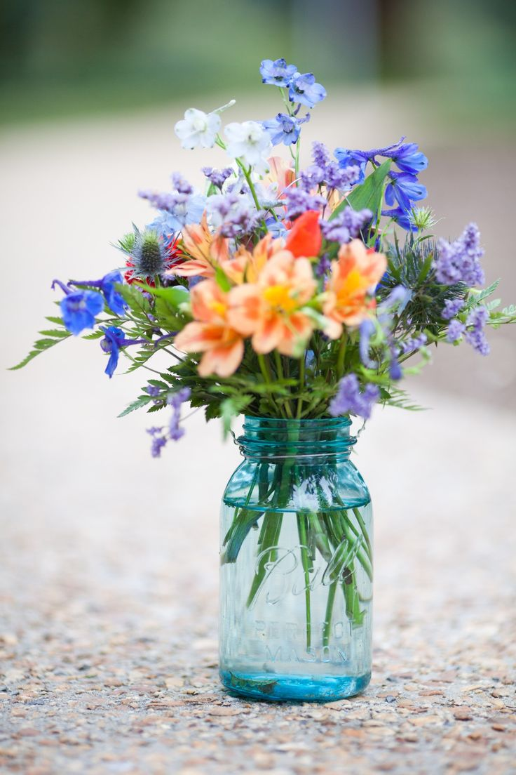 Example of multicolored flowers to use in blue mason jars for tables at reception - 1 each for 16 tables + 2 for head table. These should be a decent size.