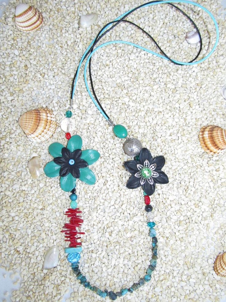 Handmade necklace (1 pc)  Made with leather flowers, leather cords, gemstones, glass beads and metal findings.