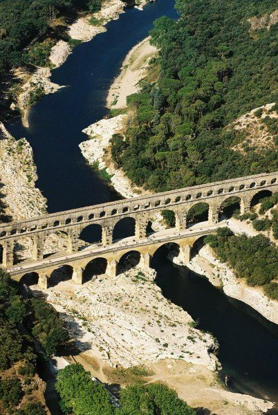 Le pont du Gard ༺✿༺ The Pont du Gard is an ancient Roman aqueduct bridge that crosses the Gardon River, from which it takes its name. It is located in Vers-Pont-du-Gard near Remoulins.