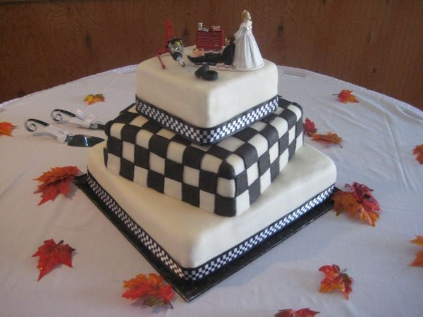 I am leaning towards this cake - with this topper!