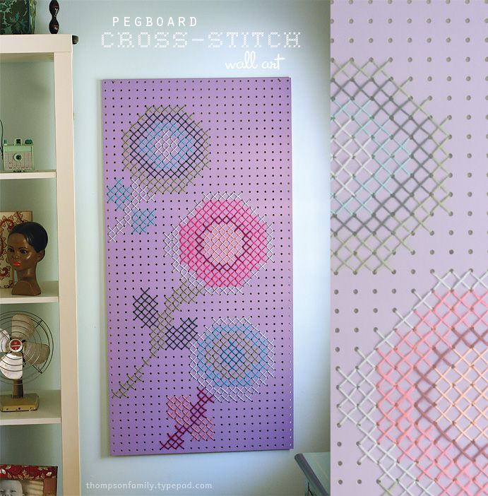 I have seen quite a few large scale cross stitches (including the two mentioned in this blog) but am most impressed with the use of peg board as the base of this design.  Love this idea.