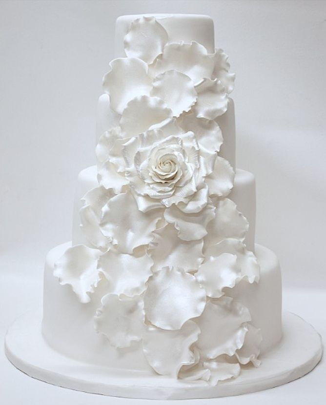 all white petal cake...see more white cakes at http://sweetvioletbride.com/2012/12/white-wedding-cakes/