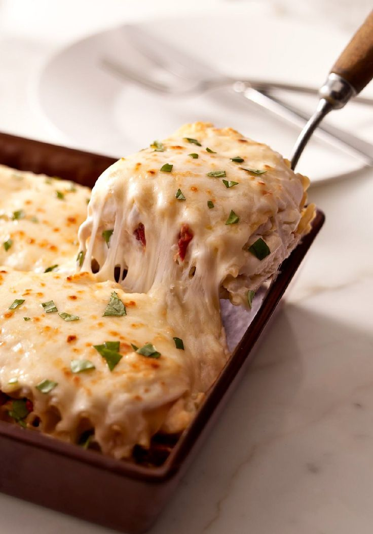 Creamy White Chicken & Artichoke Lasagna -- You may never make your regular lasagna recipe again after trying this one--with shredded chicken, sun-dried tomatoes and artichokes in a rich, creamy white sauce.