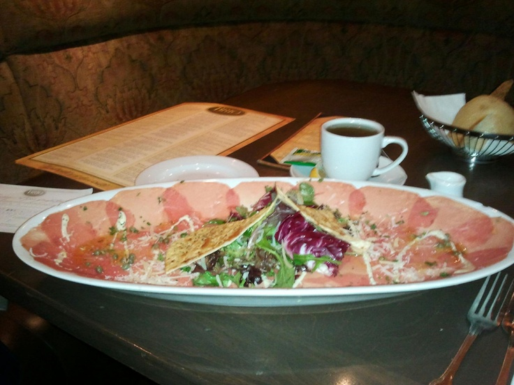 Beef Carpaccio with Spring Green Salad and Flatbread at Brio Tuscan Grille
