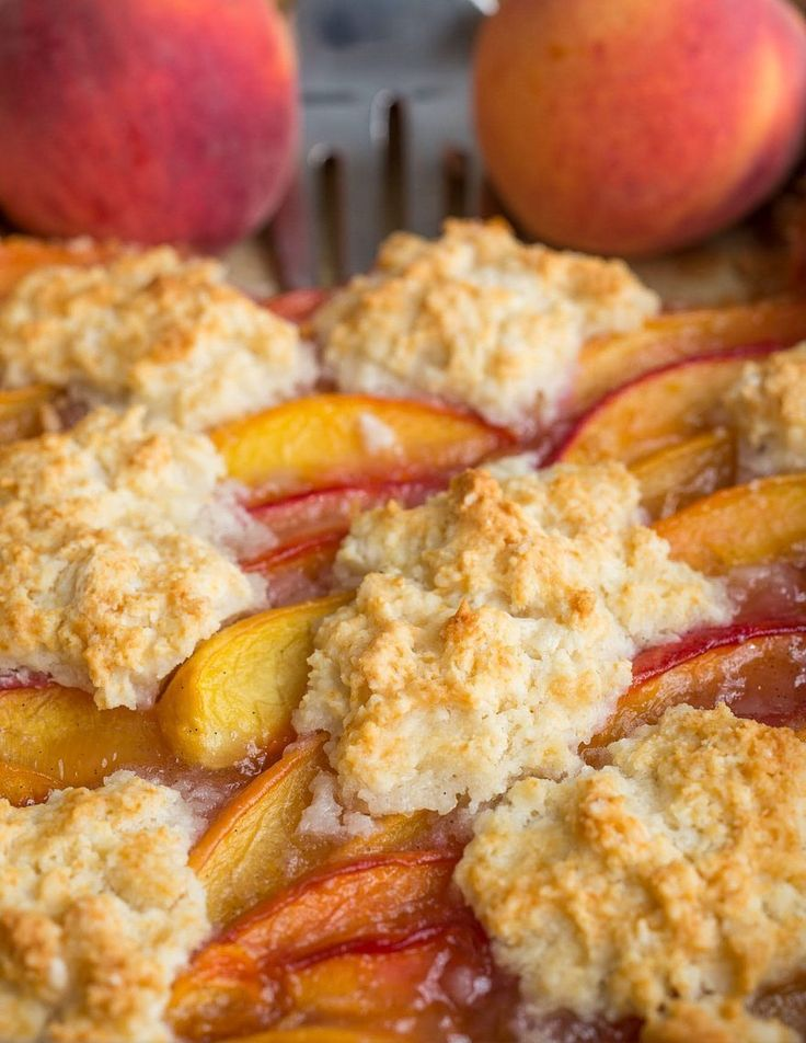 Peach cobbler bars are a fun, fresh take on the classic Southern dessert. A buttery shortbread crust makes a perfect base for the fresh peach filling, and the drop biscuit topping makes them true to their name. It's summer dessert perfection!