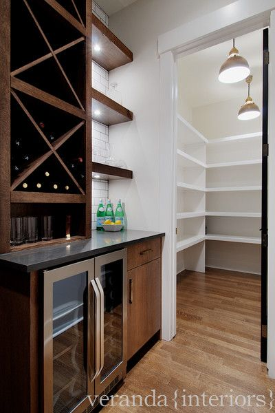 Veranda Interiors: Great wet bar/butlers pantry area. Stainless steel mini bar, chocolate brown wood ...