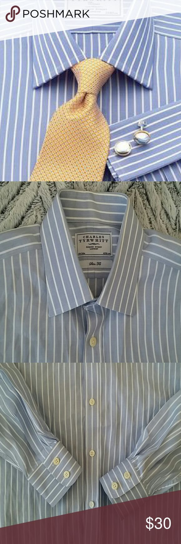 Charles Tyrwhitt Slim Fit Mens Button Down This is a luxury mens button down. Extra starched collar and cuffs. Medium blue and white pinstripe. Off white buttons. Charles Tyrwhitt, Jermyn Street London. 16.5/34in and 42/86cm. 100% cotton. Machine washable. Great used condition. Tiny pen mark on the very lower front. Barely visible. Would be tucked into a shirt anyways. Also, my camera makes it look gray. It is blue and white, like the first picture. Charles Tyrwhitt Shirts Dress Shirts