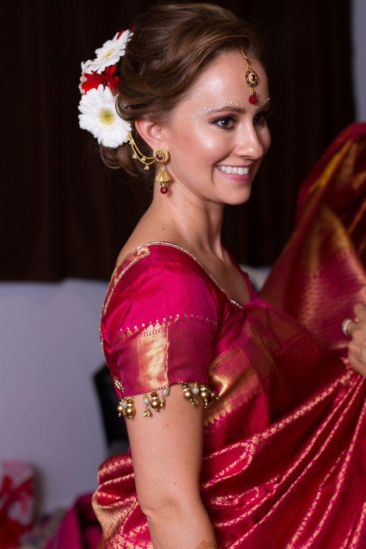 Multicultural South Indian wedding. Kanchipuram silk sari. Temple jewelry. Bun with fresh flowers.
