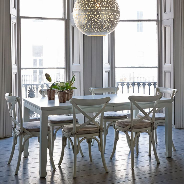 Mandara White Wooden Bistro Dining Chair. Our Mandara bistro chairs are hand carved from solid hardwood with a stylish Eastern inspired off-white distressed painted finish which offers unique hues and tones. Pair with one of our Mandara dining tables to create a striking focal point in your dining room.