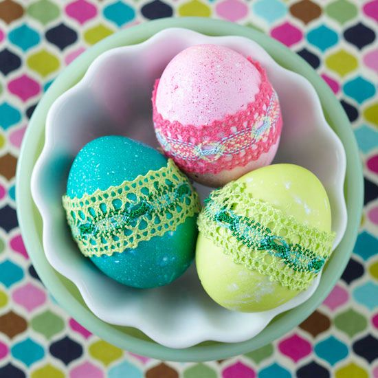 For a pretty two-tone egg embellishment, add a band of lacy fabric to match the color of your dyed egg. Cut the fabric to fit the egg (you'll need about 3 to 4 inches, depending on the size of your egg), and secure each end with hot glue.