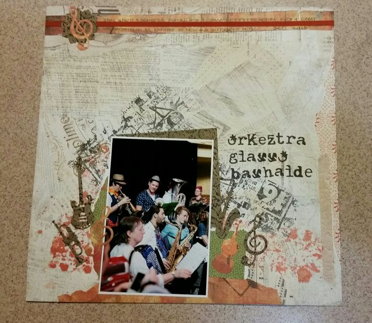 Music scrapbook page. My sons gypsy orchestra. Paper by Basic Grey.  Music die cuts by Cheery Lyn. Alphabet by Tim Holtz Thinlits
