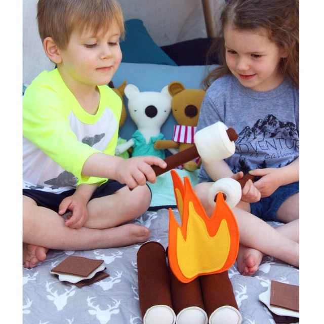 """Felt Campfire Set  - helps to inspire imaginative play in young minds. Designed and made by Mouse & Moose. Lightning Bolt Raglan by Emerson Apparel and """"Adventure is Calling' t-shirt by Thrive Lifestyle Kids. Stuffed animals are by Silly Dolls Canada."""
