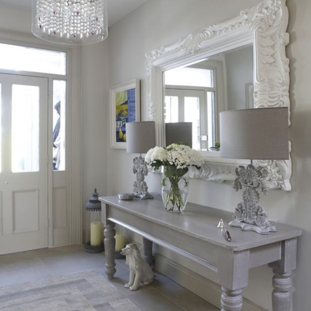 Foyer. Entryway. Grey Console Table. White Ornate Mirror. Buffet Lamps. Modern Chandelier.