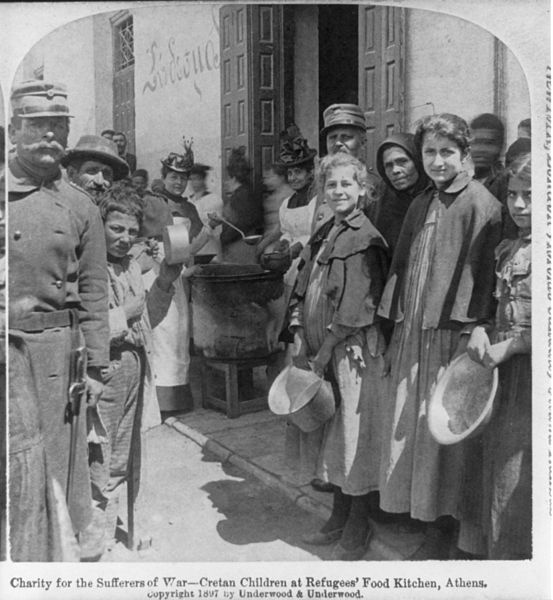 Charity for the suffers of war - Cretan children at refugees' food kitchen, Athens.jpg