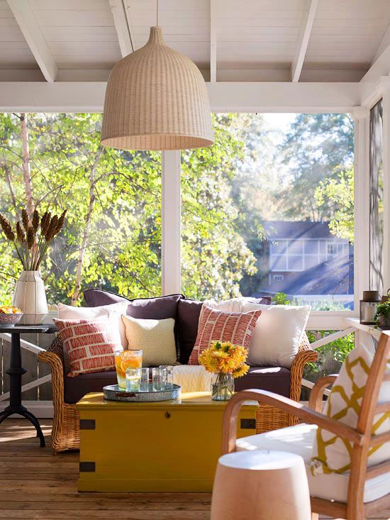 Fun accent pillows brighten this porch. More simple outdoor living spaces: http://www.bhg.com/home-improvement/porch/outdoor-rooms/small-outdoor-living-spaces/?socsrc=bhgpin050713patternpillows