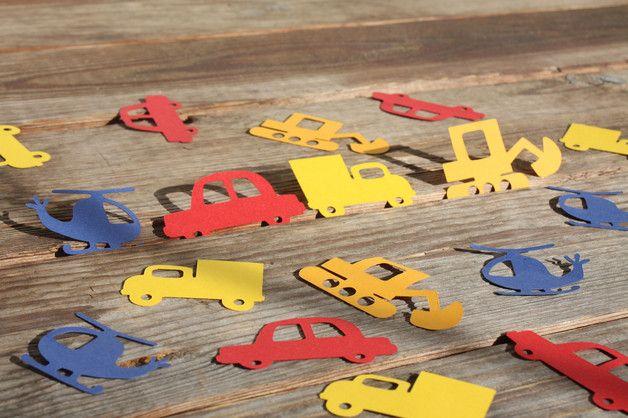40 Stck. Konfettiteile ( je 10: Bagger orange, LKW gelb, Auto rot, Hubschrauber blau)           Maße/Material:ca. 2,5 x 3,5cm, Tonpapier ca. 100g/m²  Deko ist nicht Verkaufsbestandteil!  Ihr...