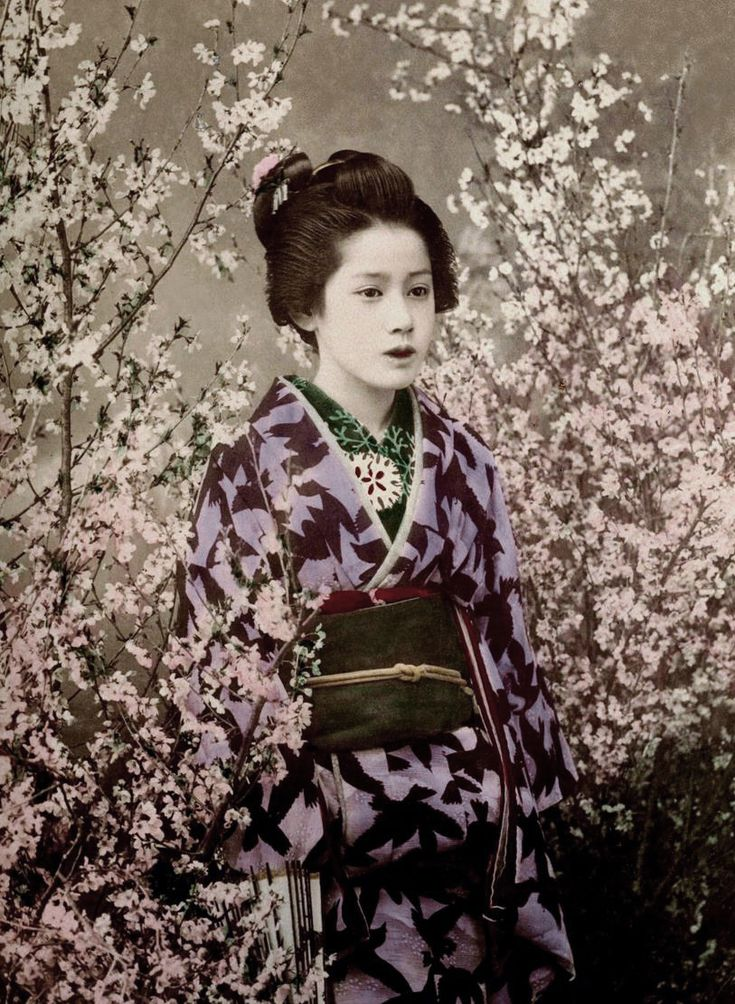 Portrait of a young woman. Hand-colored photo, about early 1900's, Japan. Photographer Kazumasa Ogawa