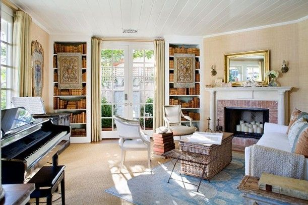 What a beautiful room. It looks so comforting, with beautiful books and other things to look at,  and it's just waiting for great conversation over tea and a musical offering, or two! To me, this is perfection.