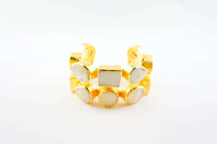 White Claudia Cuff - Alloy Metal (Nickel Free) with 18th Kt micro gold plated cuff with white agate gem stones inlays.
