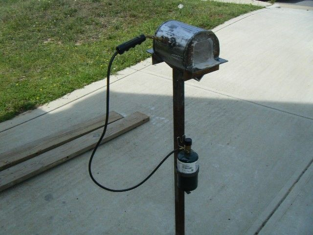 Mini Gas Forge by Pault17 -- Homemade mini gas forge constructed from tubing, angle iron, sheetmetal, cement, a gas torch, and a camping gas bottle. http://www.homemadetools.net/homemade-mini-gas-forge