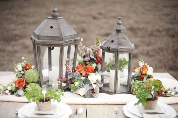 Lanterns. artichokes. roses. For mine it would be with olive branches and flowers. Plus candles!