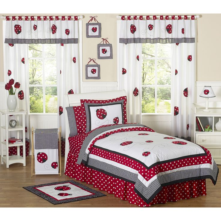 This whimsical bedding set from Sweet Jojo Designs combines cotton solid fabrics with gingham and polka-dot prints for a comfortable, adorable design. The bright ladybug appliques and embroidered swirls make this the perfect set for your little ladybug.