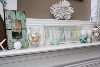 cute summer mantle- I have that frame! Love the idea- but would do some different decor..
