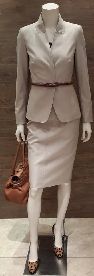 "Our femme fatale wears a classic MaxMara beige wool and silk blend tailored skirt suit with a modern touch | MaxMara tan leather belt with cotton stitch finish | Maxmara  tan deerskin leather ""Margaux"" handbag is luxurious and soft to the touch 