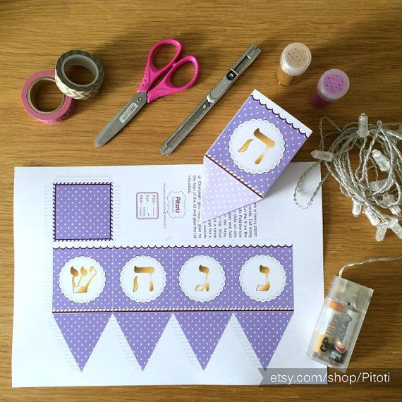 Hanukkah Dreidel Paper Craft for kids and adults - Print, colour and fold your own dreidel toy. You can also use this Dreidel template to create 3D Paper Dreidels Treat Boxes /favors for Hanukkah.  They can be filled with small candies, nuts or Hanukkah gelt, and used as cute favors at a Chanukah party.  Also works well for decorating your table, hanging on the wall or from the ceiling. In this picture you can see how I used Ikeas Saradal light chain (12 Led lights, battery charger) to light…