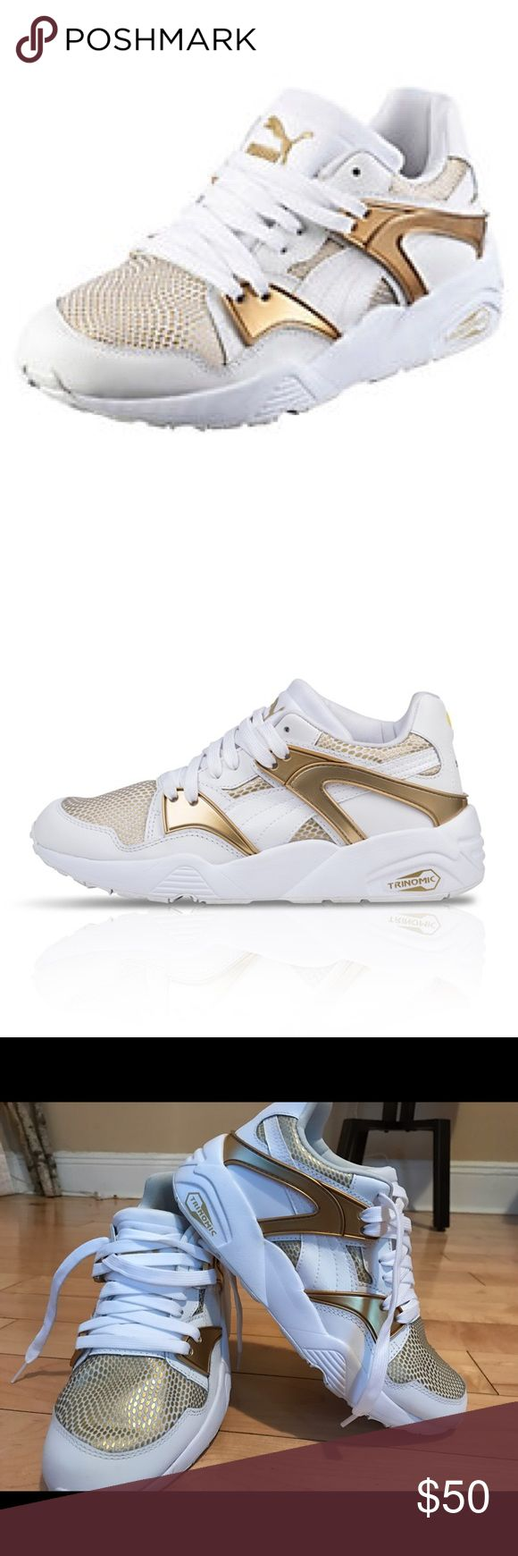 Puma Trinomic Blaze Gold & white sneakers Trinomic Blaze GOLD Women's Trainers is part of the cross-category GOLD pack, has subtle accents of gold and a futuristic distorted snake graphic, inspired by Blaze of Glory, keeping its classical Running look with the famous Trinomic tooling and the overlays. Textile upper. Stabilizing TPU forefoot and midfoot saddles. EVA midsole for great cushioning and low weight. Full-length Trinomic cushioning technology. Rubber outsole. Puma Shoes Sneakers